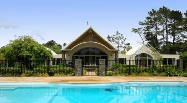 Prior to this renovation project, the existing house cottage, estate, hacienda, home, house, leisure, mansion, property, real estate, resort, swimming pool, villa, teal