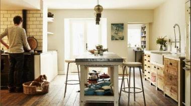 The cream Smeg fridge looks great in this floor, flooring, furniture, hardwood, home, interior design, living room, room, table, wood, wood flooring, white, brown