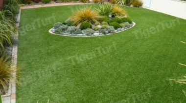 TigerTurf's artificial lawn products harmonise with the natural artificial turf, backyard, garden, grass, grass family, landscape, landscaping, lawn, plant, yard, green