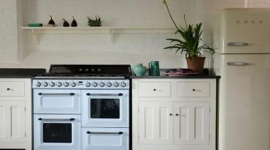 "The gorgeous new ""transitional"" kitchen features Smeg appliances cabinetry, countertop, cuisine classique, furniture, home appliance, kitchen, kitchen appliance, kitchen stove, major appliance, room, gray"