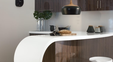 This curvy kitchen features thermoformed Laminex Solid Surface chest of drawers, furniture, interior design, product design, sideboard, table, gray