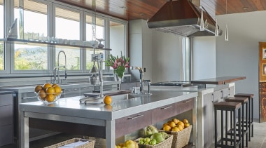 In this kitchen, the prep bench with its ceiling, countertop, interior design, kitchen, real estate, gray