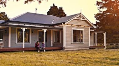 Family living in a home built with Niagara cottage, estate, facade, farmhouse, home, house, property, real estate, siding, brown