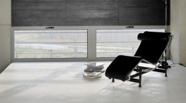 Concrete chair, floor, flooring, furniture, interior design, living room, tile, window, gray