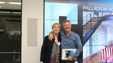 Judy Johnson with Bruce Wenzlick (Palladium Homes) communication, electronic device, technology, gray, black