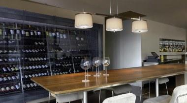 Laura from La Crue, Spain countertop, dining room, interior design, light fixture, lighting, liquor store, table, black, gray
