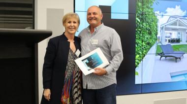 Judy Johnson with Ron Ouwerkerk (QPC Build Group) communication, electronic device, technology, black, white
