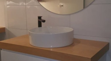 Read more about happy clients angle, bathroom, bathroom accessory, bathroom cabinet, bathroom sink, floor, interior design, plumbing fixture, room, sink, tap, tile, toilet seat, gray, brown