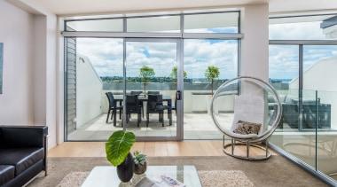 Seaview apartment, balcony, door, home, house, interior design, living room, property, real estate, window, gray