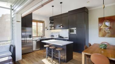 The entire kitchen revolves around the island countertop, interior design, kitchen, loft, real estate, gray