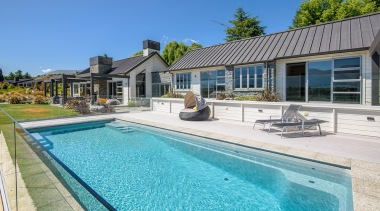 The word 'relax' comes to mind with this cottage, estate, home, house, leisure, property, real estate, resort, swimming pool, villa, teal