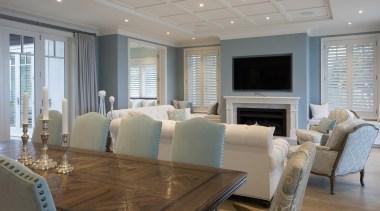 Living area ceiling, floor, flooring, home, interior design, living room, real estate, room, table, window, gray