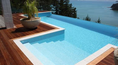 Bisazza Paroa Bay swimming pool tiles composite material, floor, leisure, outdoor furniture, property, roof, sunlounger, swimming pool, wood, teal