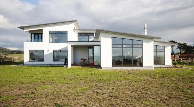Imposing modern lines define this home built by elevation, facade, home, house, property, real estate, gray, brown