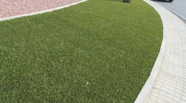 Commercial landscape artificial turf, asphalt, grass, land lot, landscaping, lawn, plant, road surface, walkway, brown, white