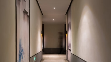 Floor to ceiling artwork lines the hallway architecture, ceiling, daylighting, house, interior design, light, lighting, lobby, gray