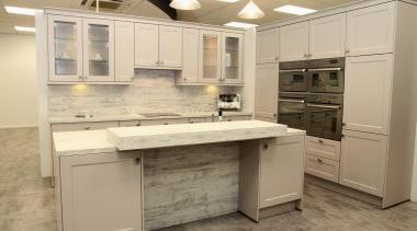 Nyon Kitchen Shot by Geneva cabinetry, countertop, cuisine classique, floor, flooring, kitchen, room, orange, brown