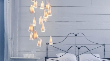 This is a low voltage chandelier; each individual furniture, home, interior design, lamp, light fixture, lighting, product, room, wall, window, gray