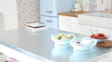 A playful kitchen in fun colours featuring a baking, furniture, interior design, kitchen, room, table, tableware, white