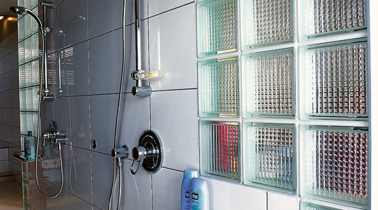 The detail of the glass bricks in a bathroom, glass, plumbing fixture, room, shelving, gray