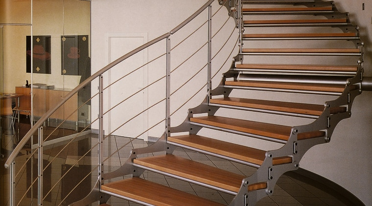 view of metal staircase from base of stairs baluster, glass, handrail, stairs, structure, wood, brown