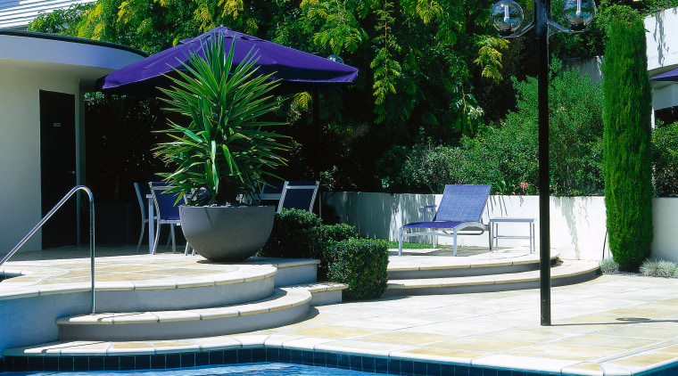 Light coloured pavers used in area around pool, backyard, estate, leisure, outdoor furniture, outdoor structure, property, real estate, resort, sunlounger, swimming pool, water, green
