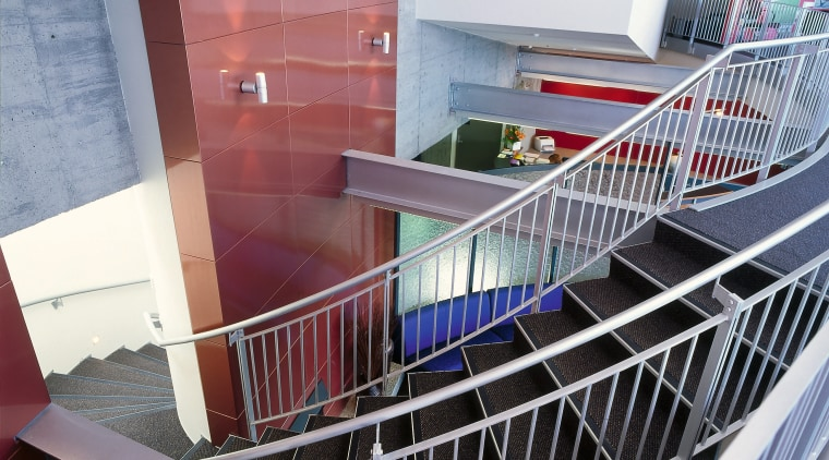 Open staircase through the centre of the offices daylighting, glass, handrail, stairs, structure, gray