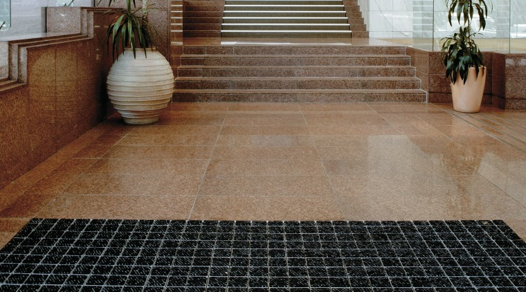 large mat in entrance area to protect tiled floor, flooring, road surface, tile, black, brown