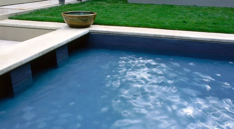 View of the pool that is the dominant backyard, floor, flooring, leisure, property, swimming pool, water, water resources, teal