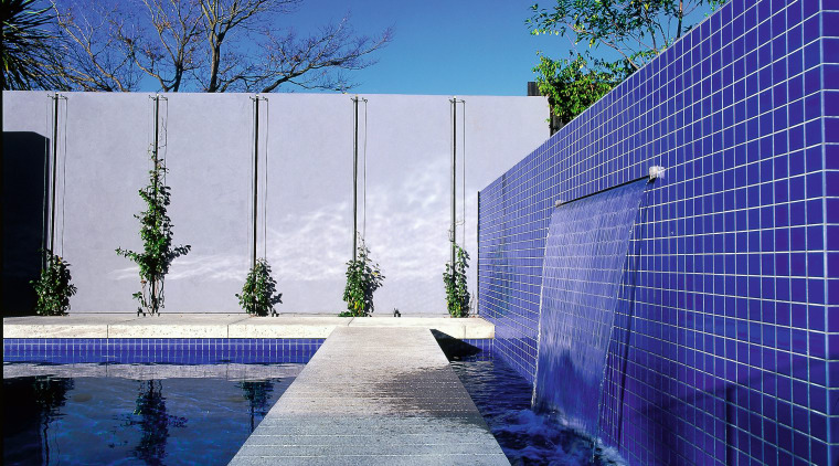 Side view of this home's water feature architecture, blue, condominium, daylighting, daytime, estate, facade, home, house, lighting, property, real estate, reflecting pool, reflection, residential area, sky, sunlight, swimming pool, wall, water, blue