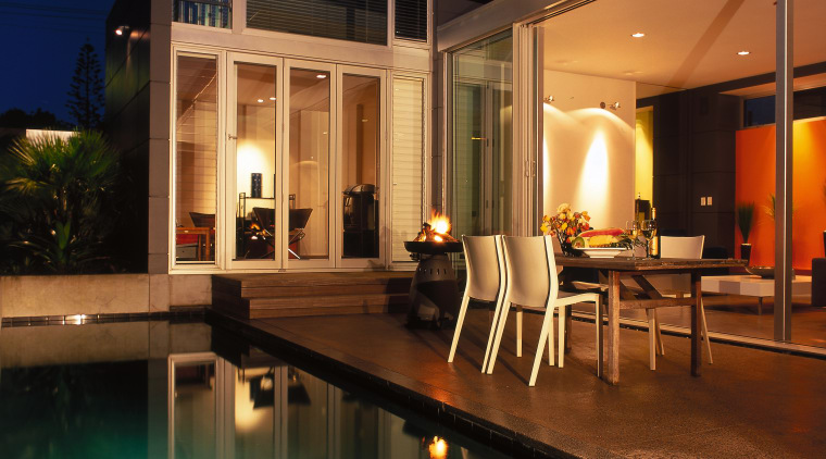 View of the patio from the pool, polished apartment, architecture, estate, home, house, interior design, lighting, property, real estate, brown, black