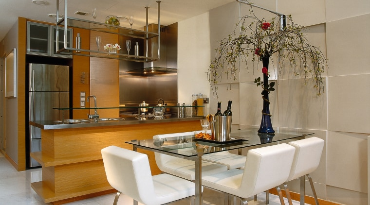 The open plan kitchen and dining area of countertop, cuisine classique, dining room, furniture, interior design, kitchen, room, table, gray, brown