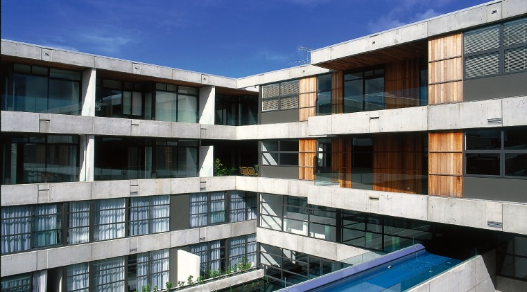 The hotel has a cantilevered lap pool. apartment, architecture, building, condominium, corporate headquarters, estate, facade, property, real estate, residential area, sky, swimming pool, window, blue