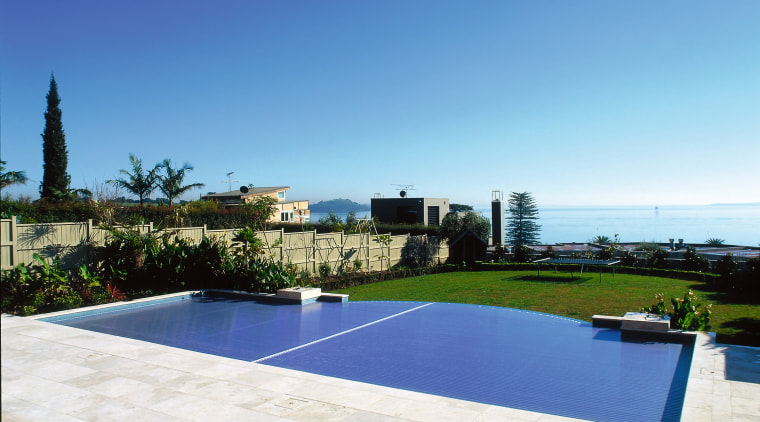 Overall view of this pool estate, home, property, real estate, residential area, resort, sky, swimming pool, villa, white, blue, teal
