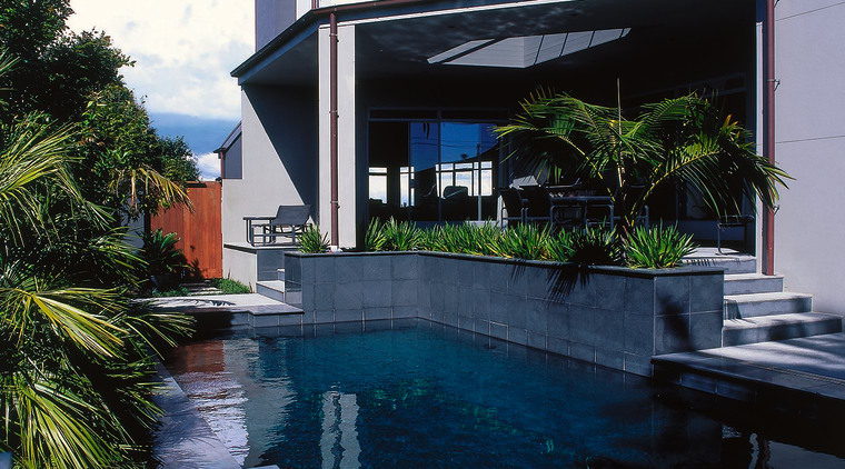 View of the pool and outdoor living area architecture, estate, home, house, property, real estate, reflection, sky, swimming pool, villa, water, blue, black