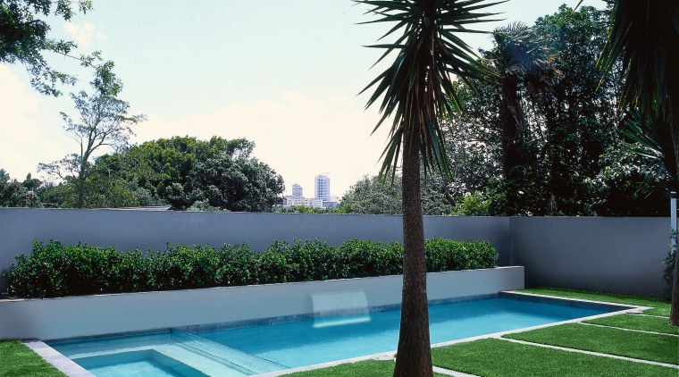 View of swimming pool and landscaped area area, arecales, artificial turf, backyard, estate, grass, house, landscape, landscaping, lawn, leisure, palm tree, plant, property, real estate, swimming pool, tree, yard, white, green