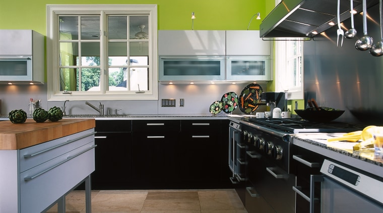 This is one corner of a colourful & cabinetry, countertop, cuisine classique, floor, interior design, kitchen, room, gray, black