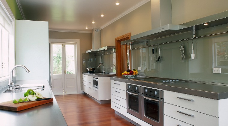 View of a seriously horizontal kitchen cabinetry, countertop, cuisine classique, floor, flooring, hardwood, interior design, kitchen, real estate, room, wood flooring, gray