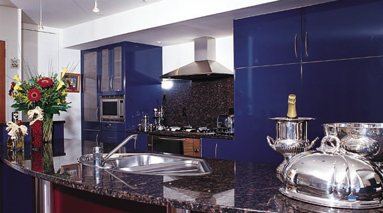 A kitchen that is strong on looks countertop, interior design, kitchen, real estate, gray, red