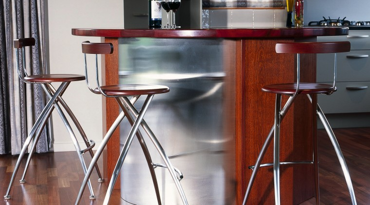 These are bar stools with style chair, countertop, desk, floor, flooring, furniture, kitchen, product design, table, red, gray