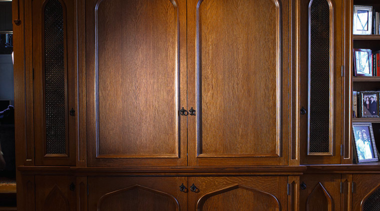 View of the cabinetry bookcase, cabinetry, cupboard, furniture, hardwood, shelving, wardrobe, wood, wood stain, brown