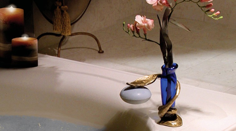View of the soap holder flower, still life photography, table, tap, gray, brown
