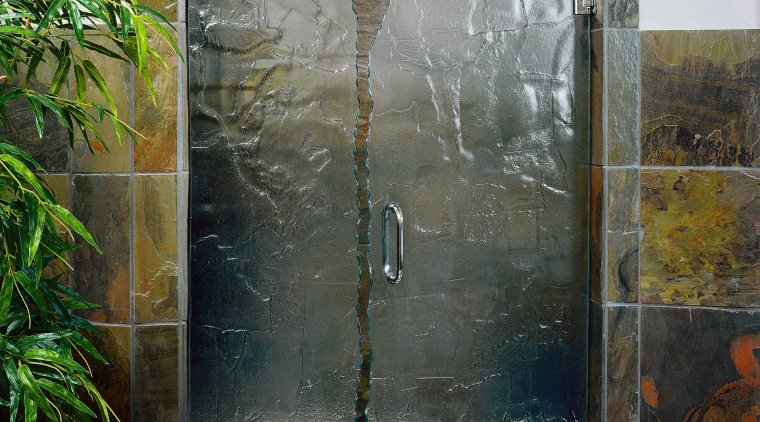 View of the door in this bathroom shower door, glass, wall, window, black, gray