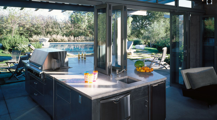 View of the kitchen area with indoor/outdoor flow outdoor structure, real estate, window, black