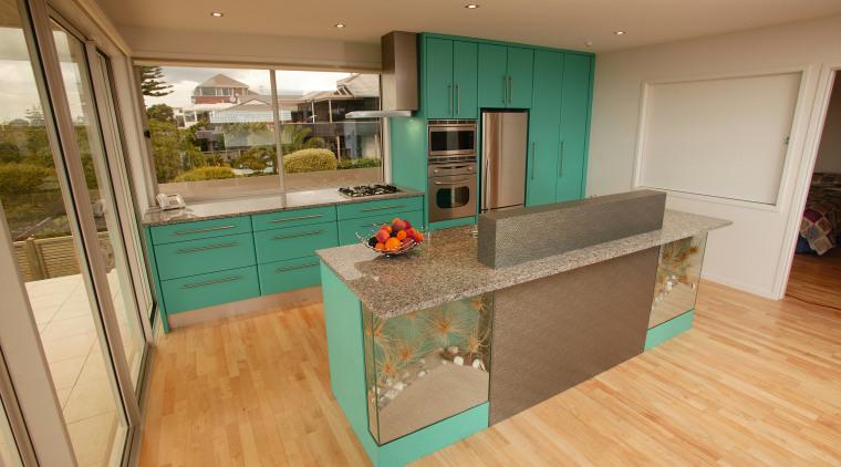 Kitchen with green cabinetry, stainless steel finish refrigerator, countertop, floor, flooring, interior design, kitchen, real estate, room, orange, brown