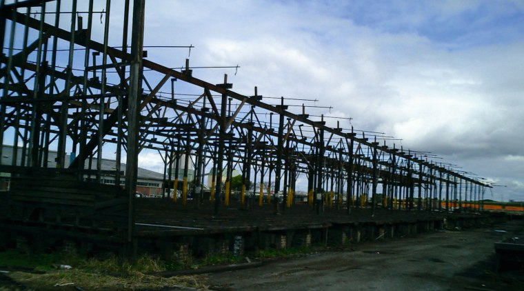 Old warehouse showing old wooden beam structure. bridge, cloud, fixed link, girder bridge, sky, skyway, structure, black, teal