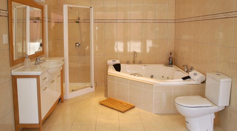 Bathroom with natural coloured wall and floor tiles, bathroom, bathtub, floor, flooring, property, room, tile, orange