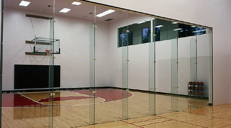 View of the glass door separating the two ceiling, floor, flooring, glass, hardwood, interior design, sport venue, structure, table, wall, gray