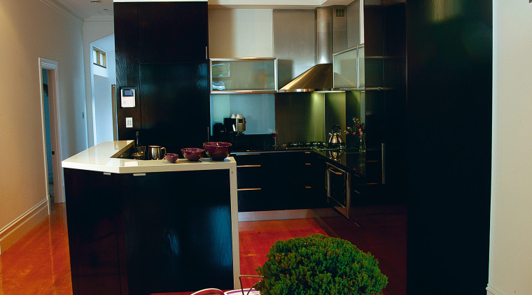 Kitchen with dark cabinetry, light benchtop, and rangehood cabinetry, countertop, interior design, kitchen, room, black