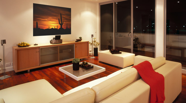 View of family room featuring a projector with interior design, living room, real estate, room, orange
